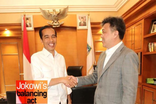 """I am aware that there are domestic political pressures to limit foreign expansion, including in the financial services and plantations sectors. Still, to ensure future rapid economic growth we need massive investments,"" Jakowi (left) said in an interview with The Star's Wong Chun Wai (right) - AZMAN GHANI/The Star"""