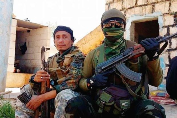 Ready for action: Lotfi (left) with another militant jihadist in Syria.