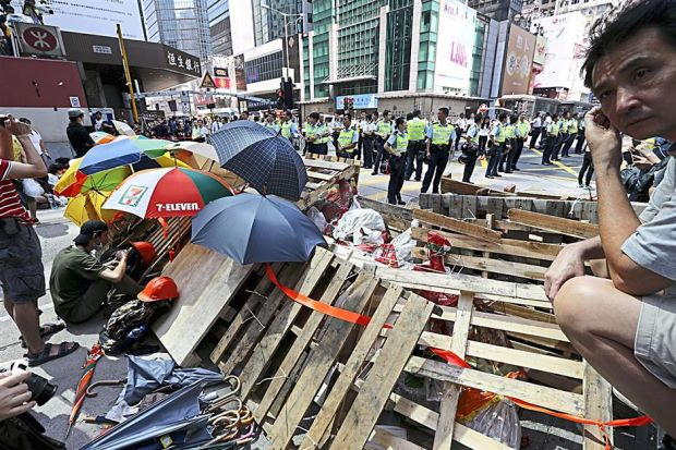 Makeshift roadblock: Pro-democracy protesters re-occupying Argyle Street after police dismantled their barricades in Mongkok. - EPA